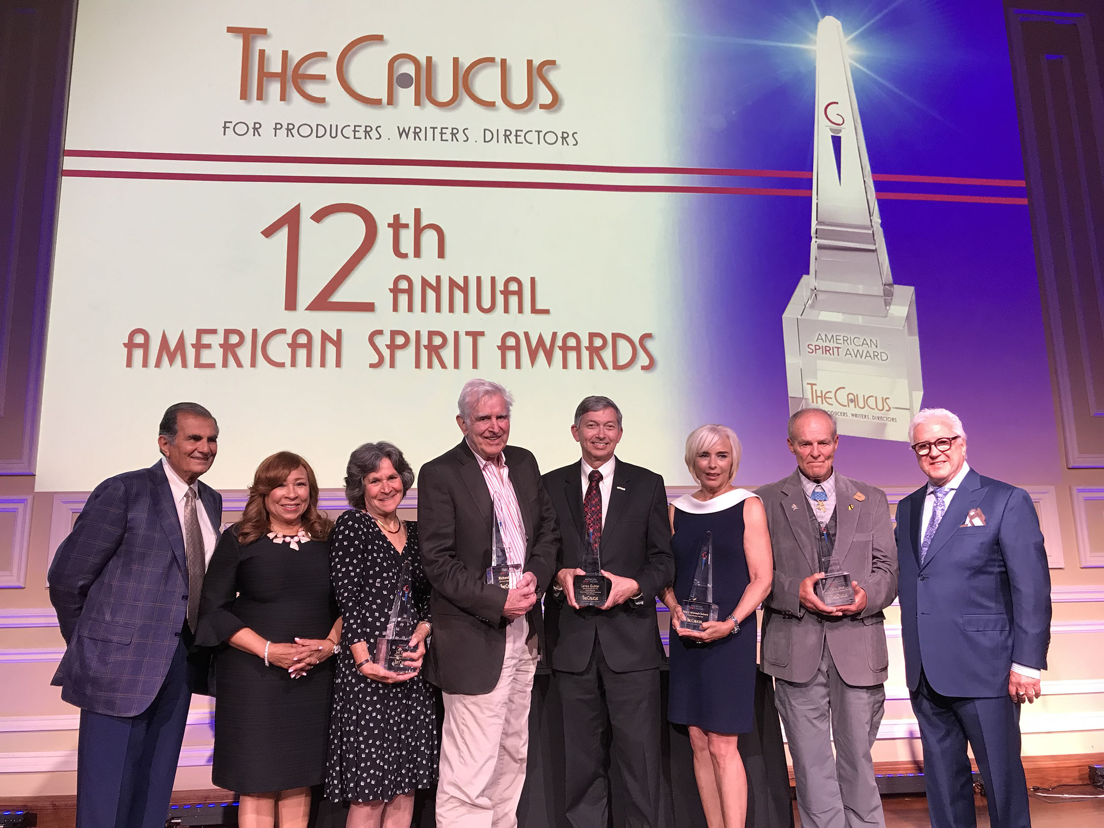 Pictured from left: The Caucus Co-chairs Robert Papazian, Tanya Hart and honorees Jan Krawitz, Richard Colla, Leron Gubler, Nancy Alspaugh-Jackson, John Baca and Executive Producer Vin Di Bona at the 12th Annual American Spirit Awards presented by The Caucus For Producers, Writers & Directors at Taglyan Complex, June 21, 2018. Photo by Marlene Panoyan.