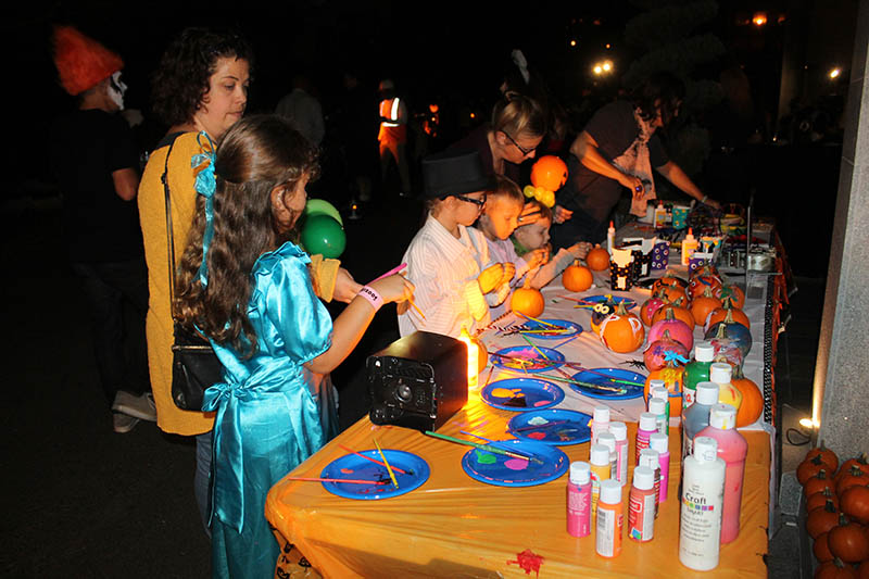 Children creating creepy creatures at the All Hallows' Eve Fundraiser.